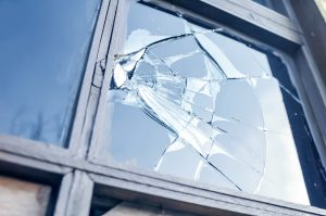broken pane of glass in window